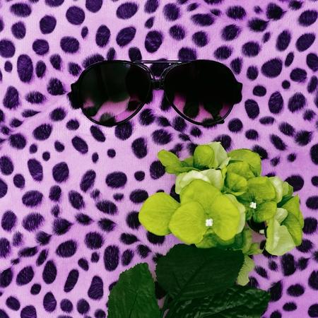 Stylish Accessory Glasses on leopard print background