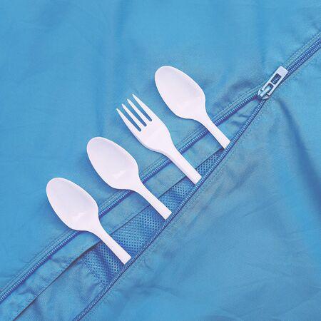 easing: Plastic dishes on blue. Minimalism art
