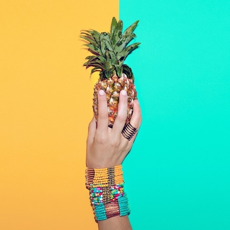 Bright stylish bracelets and Pineapple. Go to the beach. Tropical fashion mix.