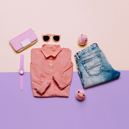 Ladies Fashion Clothes and Accessories. Purse, watches, sunglasses. Pink shirt and jeans. Pastel colors Trend Minimal Summer Stock Photo