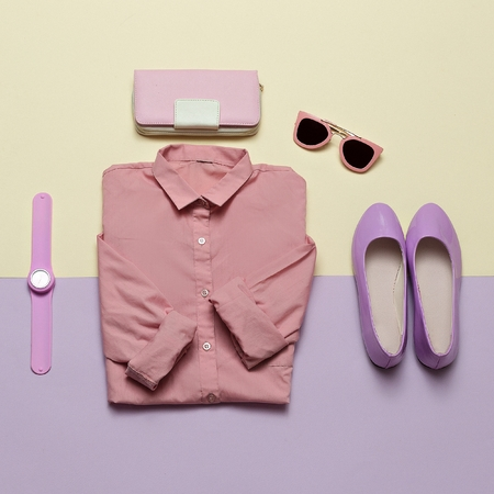 Ladies Fashion Clothes and Accessories. Purse, watches, sunglasses. Pink shirt and shoes. Pastel colors Trend Minimal Summer Stock Photo