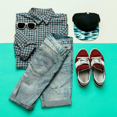 strip shirt: Urban clothing set. Plaid shirt, jeans, sneakers Skateboard style Stock Photo