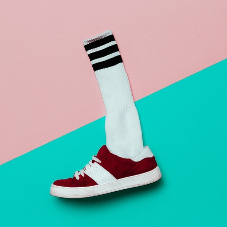 teen golf: Flat lay fashion set: Fashion skateboard shoes and fashion socks. minimal background. Hipster style. Top view.