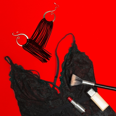 Sexy underwear and accessories. Cosmetics. Lace and earrings. Priority of black and red. Classic fashion concept