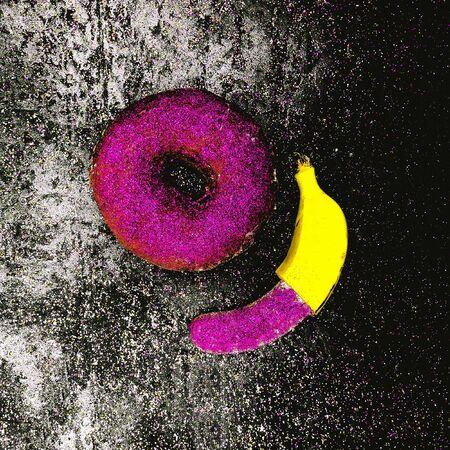 Glitter couple Banana and Donut Minimal surreal design Shining fashion art Stock Photo