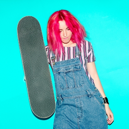 tenager: teen girl with pink hair and skateboard Urban Style Jeans Fashion
