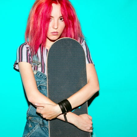 tenager: teenager girl with pink hair and skateboard Urban Style Jeans Fashion