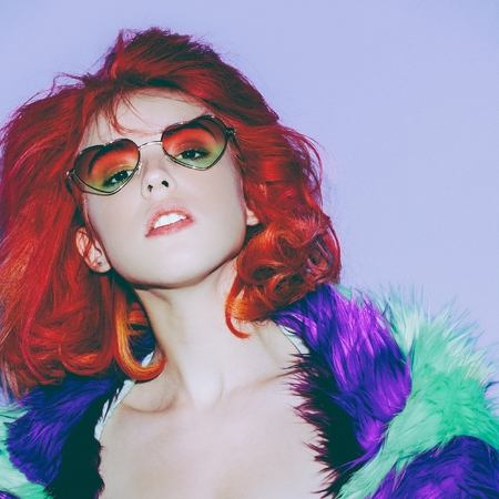 vulgar: Sensual lady with red hair in the bright coat, Sunglasses hearts Club Style Party Stock Photo