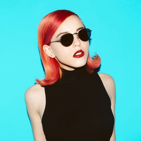 Retro Lady with red hair and stylish glasses.