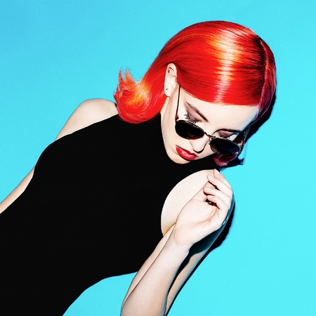 Elegant lady with red hair and stylish sunglasses. retro mood