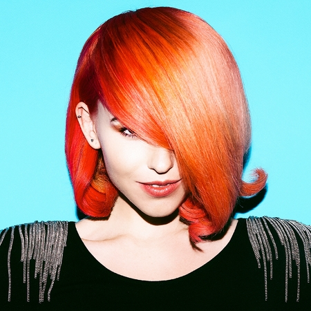 stylish hair: Elegant lady with stylish hair. Hair Color Trend. Red hair