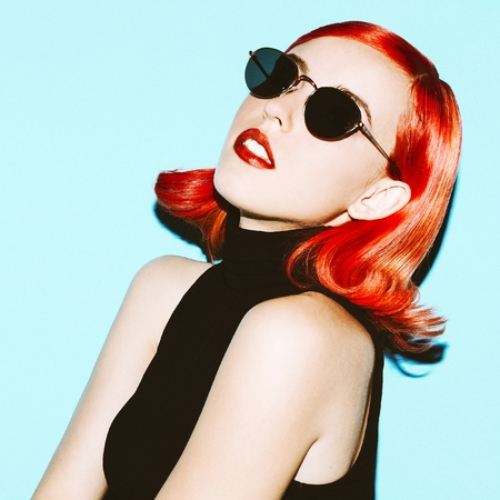 stylish hair: Beautiful lady with elegant hair and stylish sunglasses. retro mood