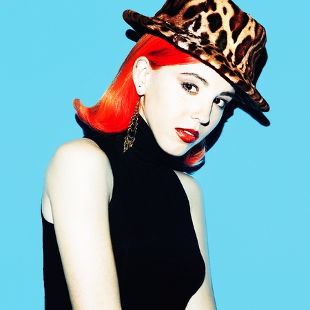 Girl with red hair and a fashionable hat. Trend Autumn.