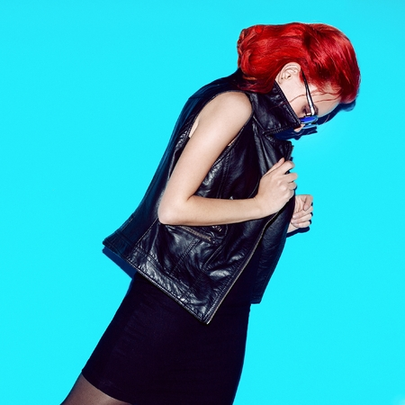 Sensual model with fashion hair. Red hair color. and trendy rock style