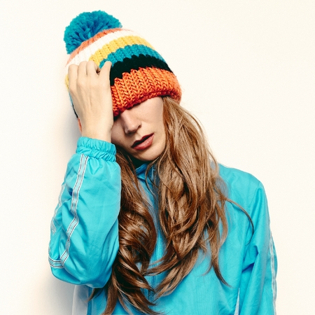 pompon: Stylish brunette in a hat with pompon Snowboard fashion Stock Photo