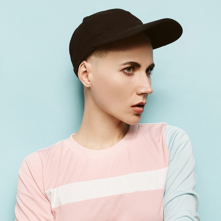 Hipster girl style, cap, sport, happy and positive girl, b-boy cap, swag style, beauty fashion model stylish accessories Urban
