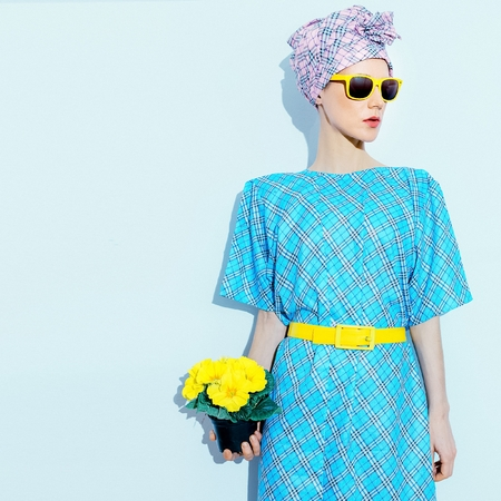 Lady in vintage dress and headscarf. Checkered print trend.