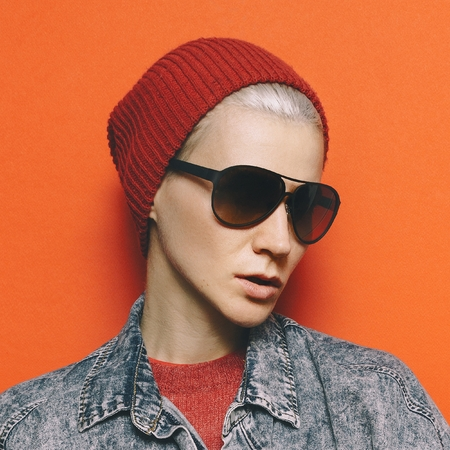 Fashion concept Blue denim clothes Stylish Model Tomboy hipster fashion Urban Style Beanie Sunglasses