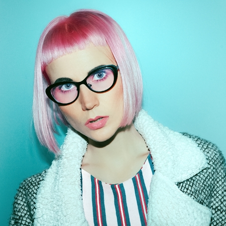 stylish hair: Stylish girl in fashion sunglasses with pink hair