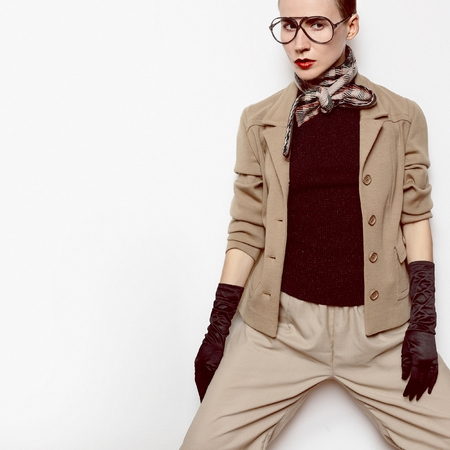 Vintage Fashion Woman Beige classic suit and stylish eyewear. Glam retro style trend Autumn winter