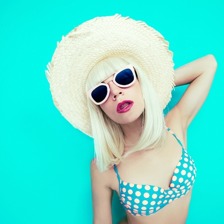 Lady in Swimsuit Polka dot on a blue background. Retro Summer Style