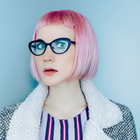 stylish hair: Model with pink hair stylish and trendy glasses