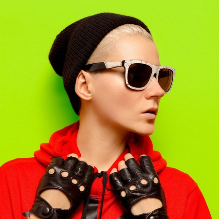 Stylish girl in autumn accessories. Hat, gloves and sunglasses. Swag Stock Photo