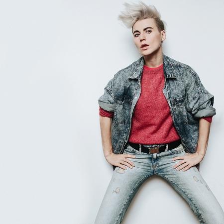 Fashion concept glam rock style Denim clothing Glamorous Tomboy Hipster Blonde Stock Photo