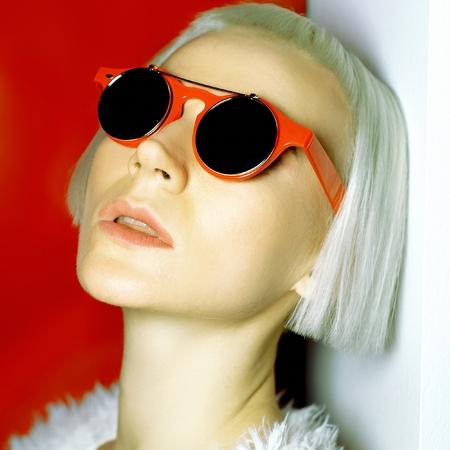Glamorous blonde fashionable hairstyle and trendy sunglasses. Stock Photo
