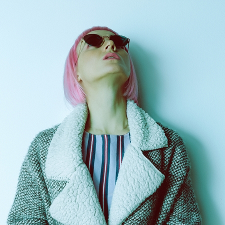 Pop Lady in trendy sunglasses and  pink hair. Stock Photo