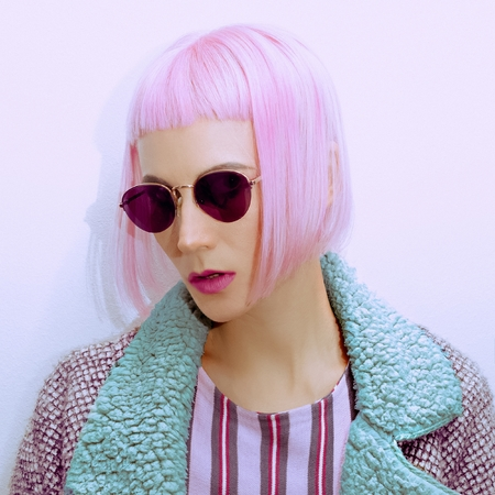 Fashion girl in vintage sunglasses and trendy haircut