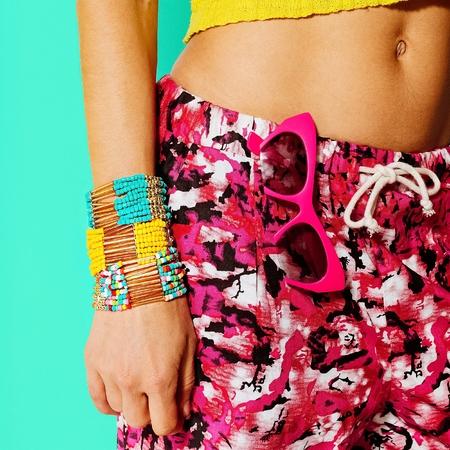 abdomen yellow jacket: Bracelets, sunglasses. Bright summer style Lady.