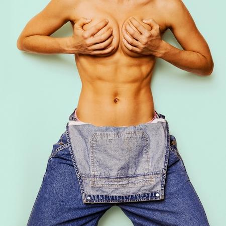 Stylish hipster model Denim Urban fashion denim coveralls Sexy athletic body