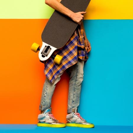 rocker girl: Skateboard Fashion Girl. Minimal design. Stylish clothes Foto de archivo