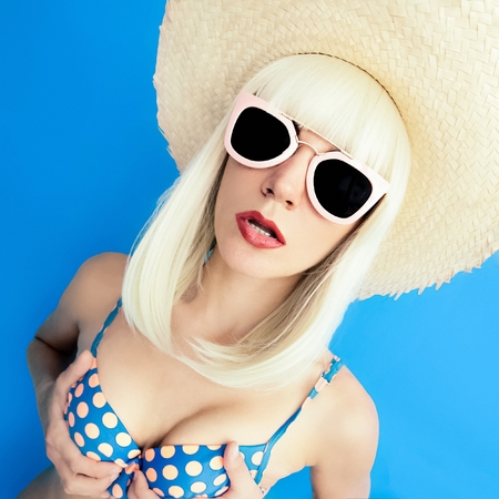 Blonde in Swimsuit Polka dot on a blue background. Retro Party Beach Style