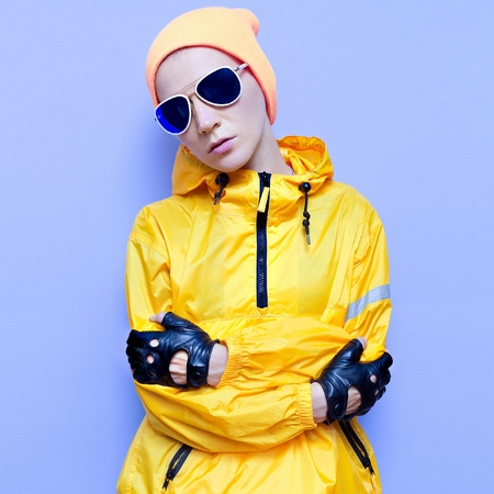 Snowboard clothing fashion. Model in fashion accessories. Orange and blue air
