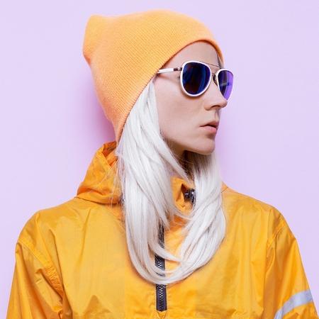 Snowboard clothing fashion. Blonde in fashion accessories. Orange