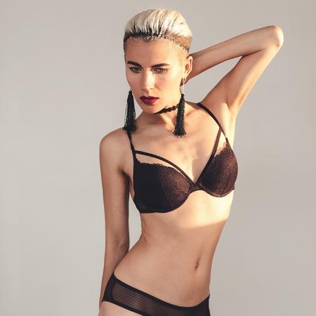 sexy model: Sexy Blonde model in beautiful underwear and accessories. Trend Choker & Earrings.