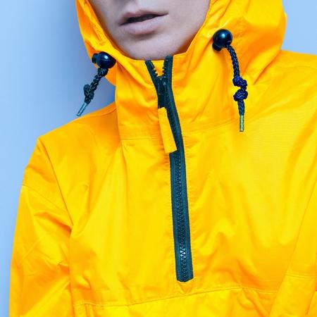 Orange jacket and blue cold air. Details fashion