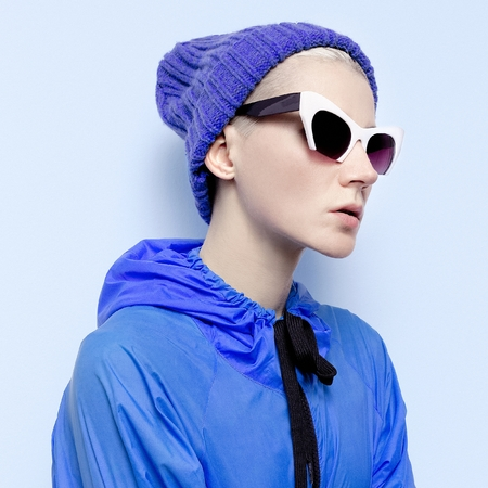 Hipster girl in stylish blue clothes Autumn Winter fashion