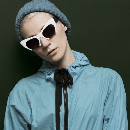 Lady hipster in stylish blue clothes Fall Winter fashion