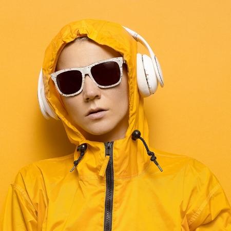 dubstep: Model DJ yellow sportswear and accessories. Bright season. Snowboard party