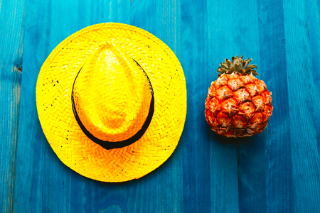 Pineapple and straw hat. Beach cocktail. Tropical Minimal. Fresh ideas Stock Photo - 77223807