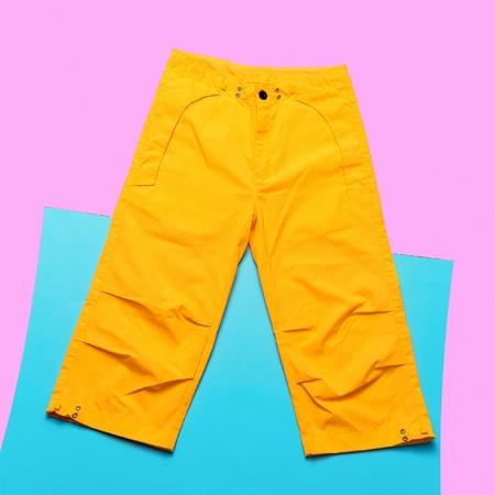 teen golf: Yellow pants hipster trend. Minimal design fashion