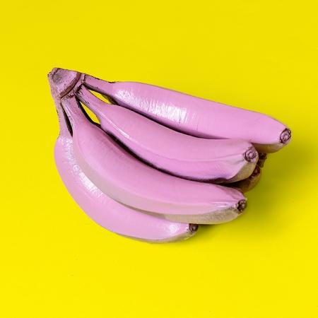 Bananas in pink paint. Surreal minimal art