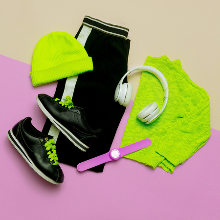 strip shirt: Fashion Outfit for women. Stylish clothes and bright accessories. Sports Urban. Minimal. Top view Headphones and Watches Active life