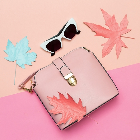 Fashionable Pink Bag and retro sunglasses for lady. Spring vibration. Concept Minimal design art