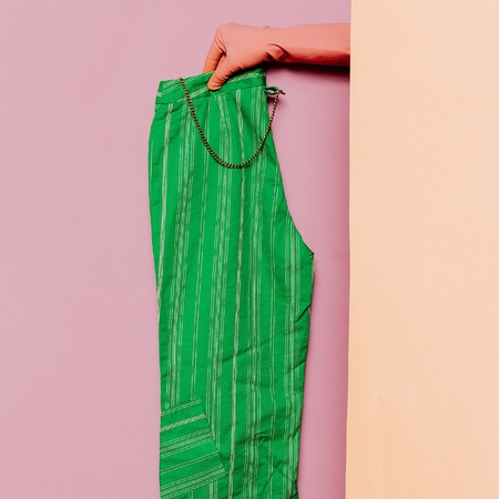 green clothes: Stylish clothes. Summer green pants. Strip print trend wardrobe ideas Stock Photo