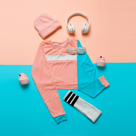Stylish sports blouse and accessories. Top view. Minimal. Hipster style. Pastel color trend