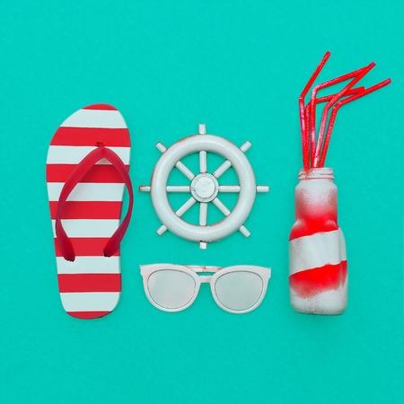 fashion photos: Beach season. Marine style. Flip-flops and beach cocktail. Minimal art Stock Photo